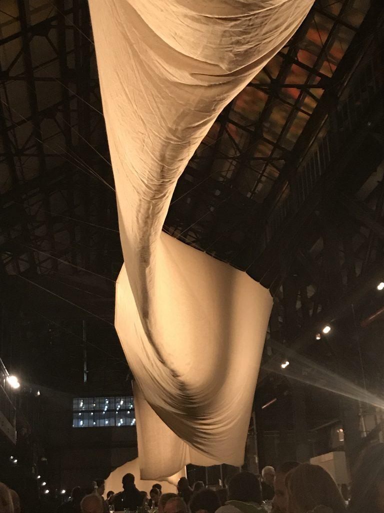 Freeform wave-like burlap and canvas installation