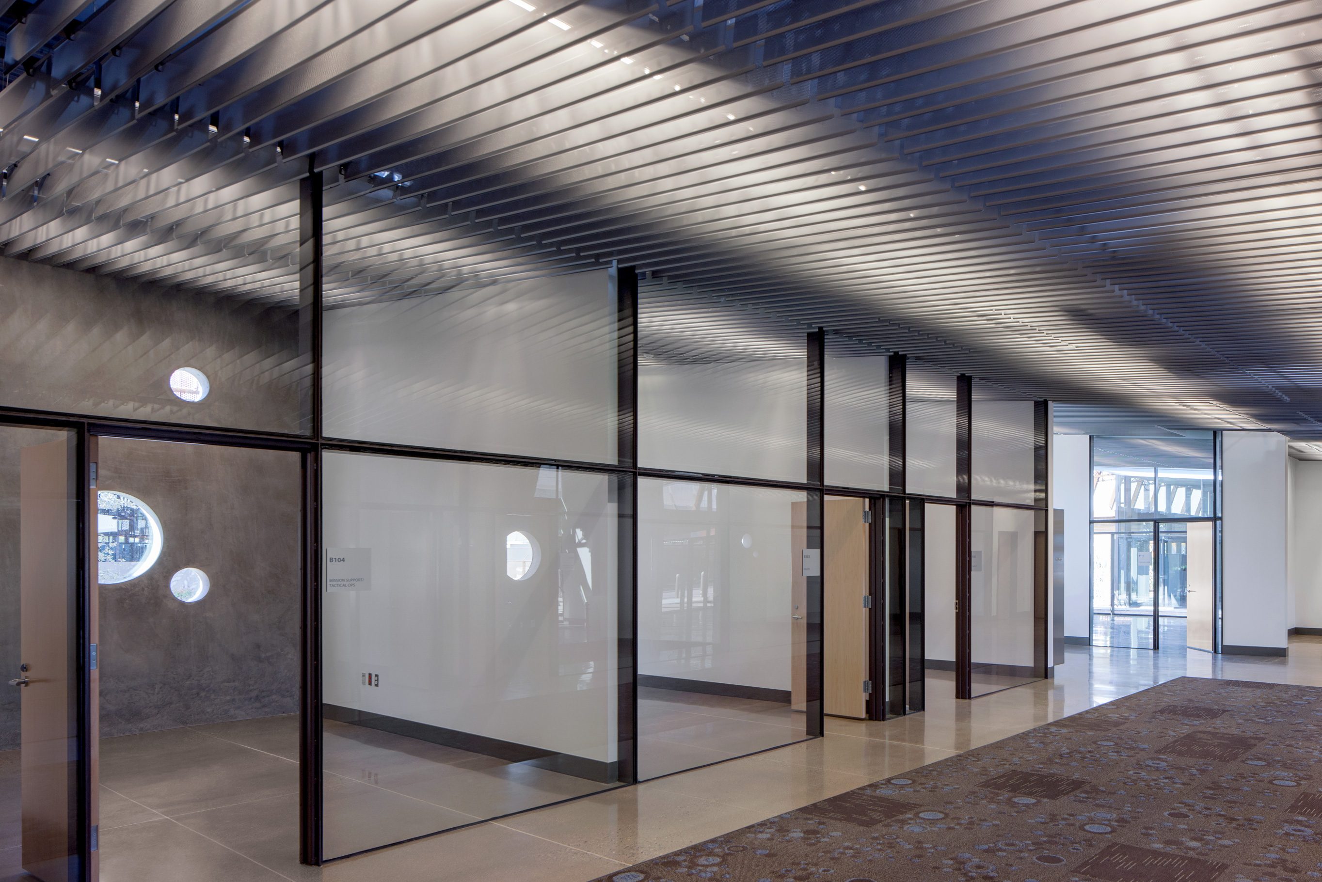 The perforated metal fin ceiling system created a louver that allowed lights, diffusers, sprinklers and AV systems to be stored together out of sight.