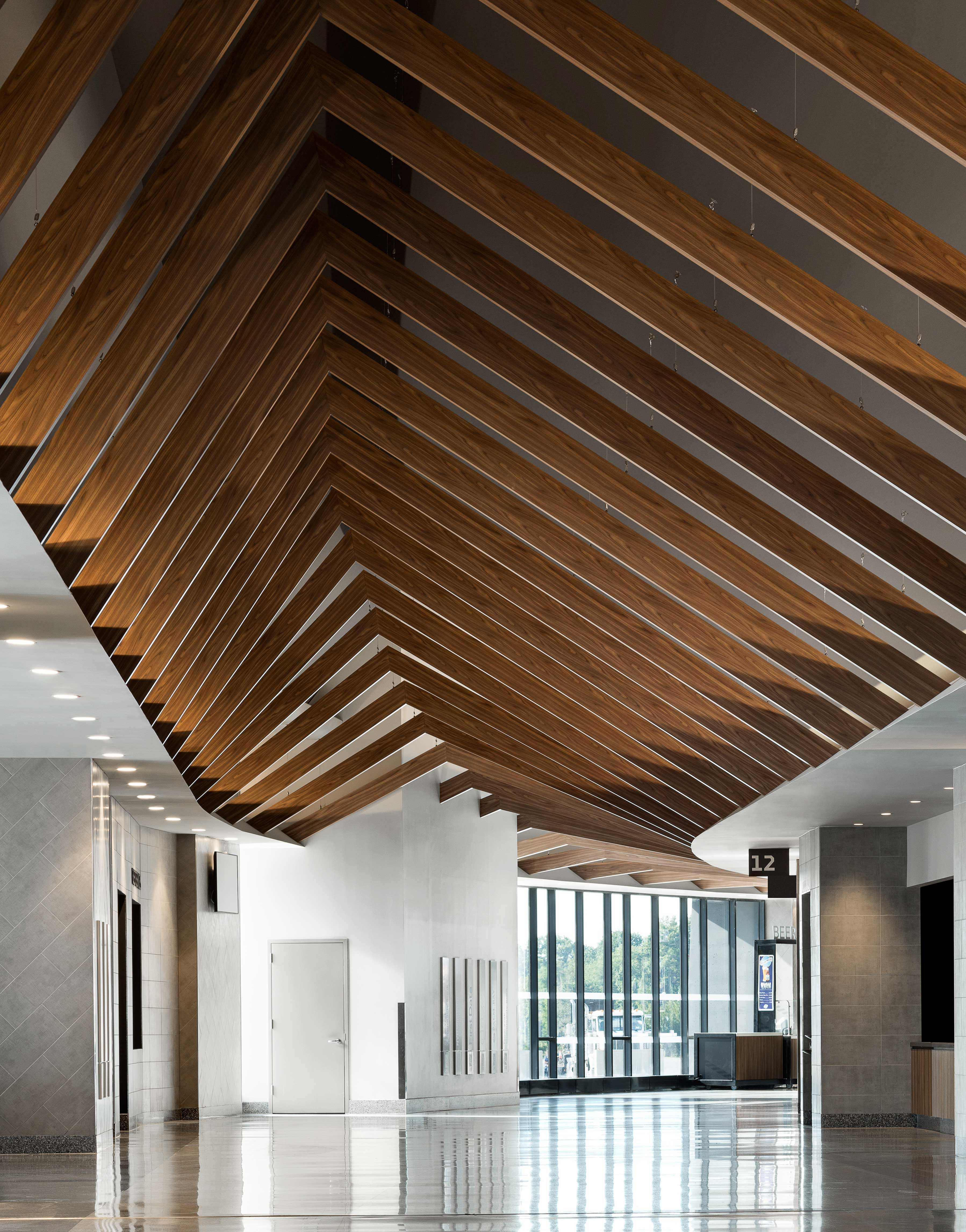 """Here, Hunter Douglas' engineering team worked to design each beam's length and angle, varying each to establish a visual """"wave effect."""""""