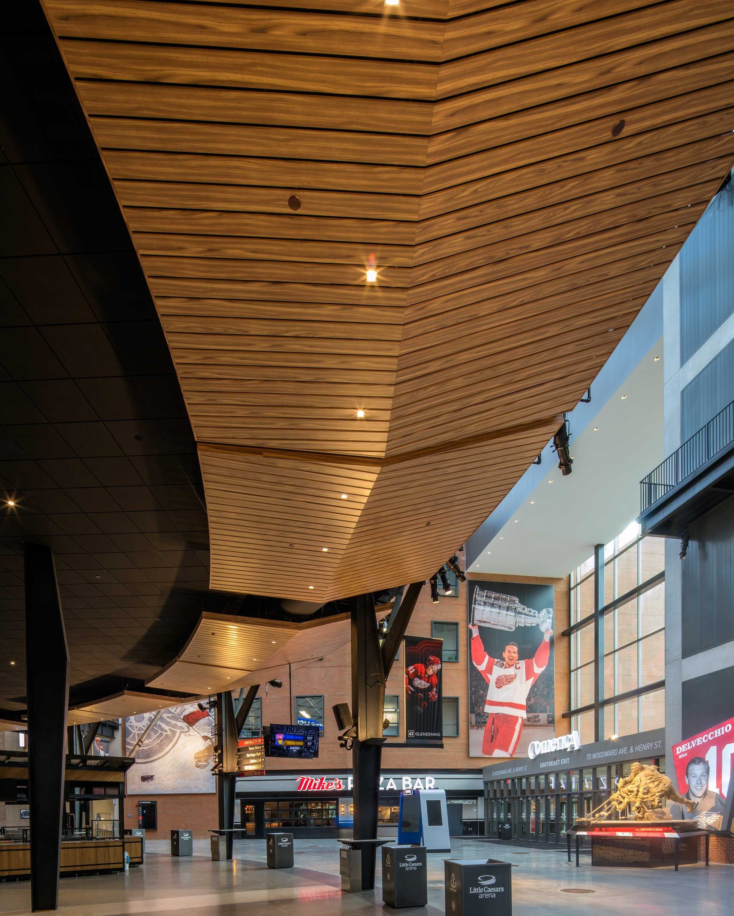 """Linear ceiling panels join together to form an inverted """"v"""" peak that curves around the concourse."""
