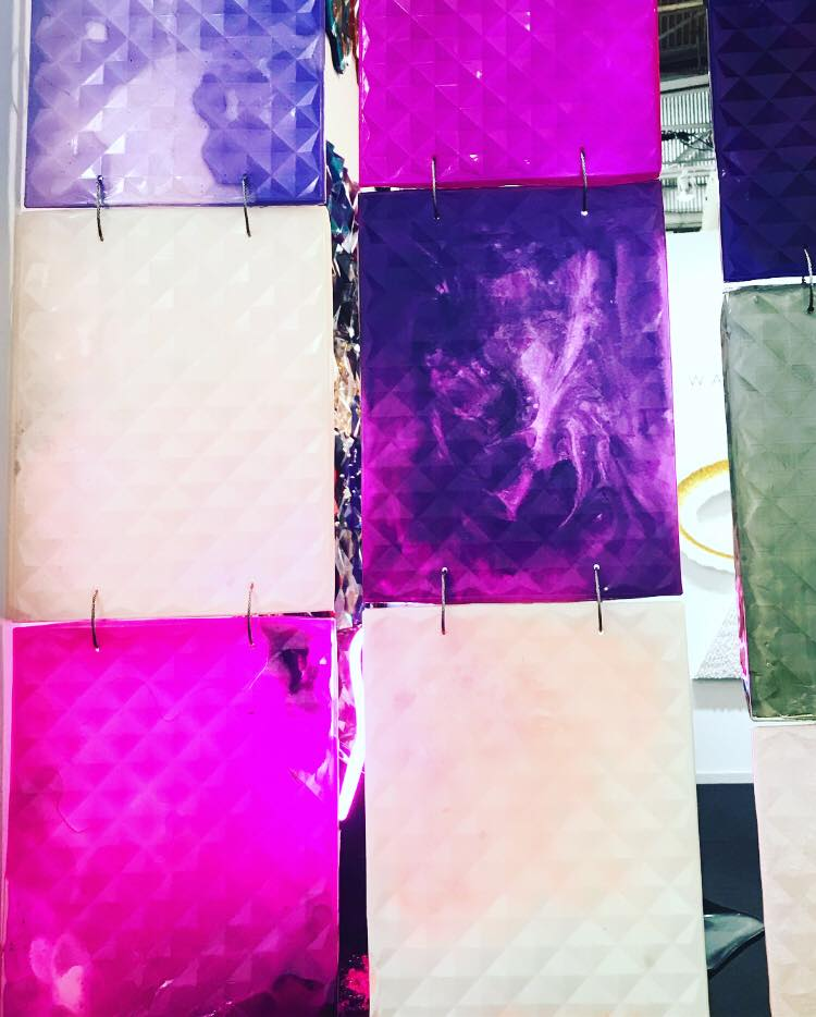 """Hanging """"swatches"""" of Marco Guglielmino's multidimensional resin tiles reveal varying luminosities and effects brightness."""