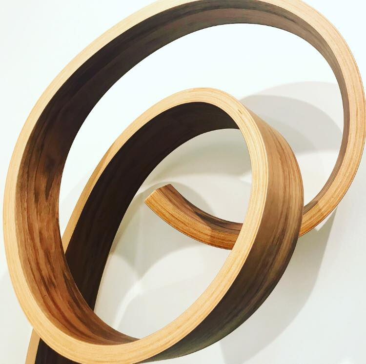 Wood is made into tables, shelves and books that twist, turn, curve and curl.