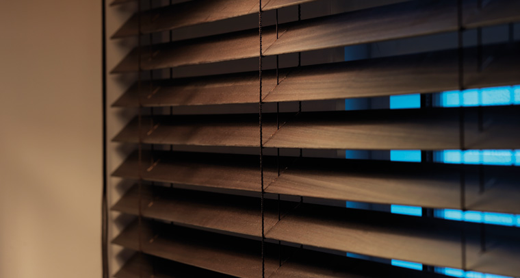 Bring the outside in with wood blinds.